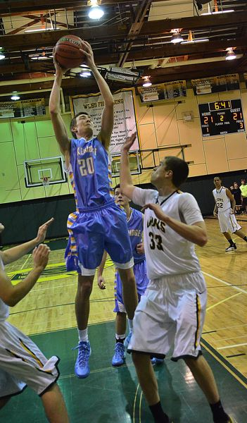 by: VERN UYETAKE - Lakeridge's Joe Sindlinger gets a shot off in the Pacers' game against West Linn.