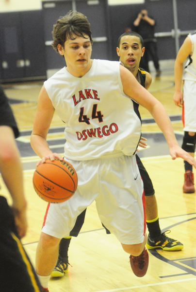 by: MATTHEW SHERMAN - Lake Oswego's Max Dinesen drives to the hoop in the Lakers' game against No. 1 West Linn Tuesday.