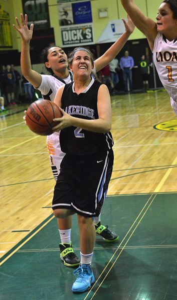 by: VERN UYETAKE - Shea Northfield gets to the rim in Lakeridge's loss to West Linn last week.