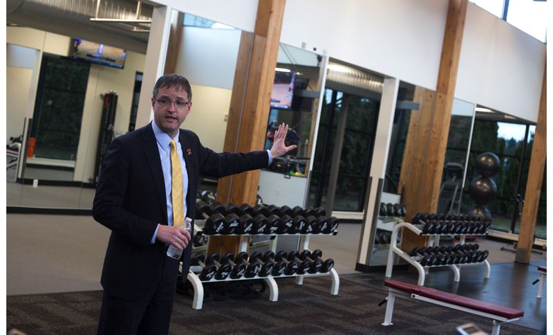 by: TRIBUNE PHOTO: JONATHAN HOUSE - Chris Oxley, general manager of Rose Quarter Operations, leads a media tour of the new amenities of the Blazers' practice facility, including the new weight room.