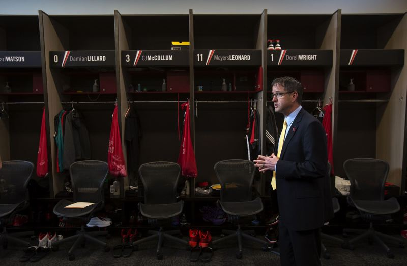 by: TRIBUNE PHOTO: JONATHAN HOUSE - Chris Oxley shows off the new locker room for the Blazers at their Tualatin practice facility.