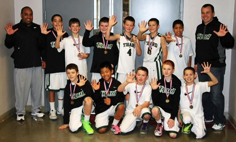 by: ED KOHLMAN - ANOTHER TITLE -- The Tigard fifth-grade elite boys basketball team recently won its fifth straight tournament championship.