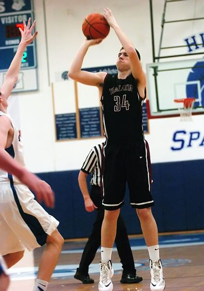 by: DAN BROOD - ON THE MONEY -- Tualatin junior Jacob Bennett sank five three-pointers in the first half of Friday's game at Hillsboro.