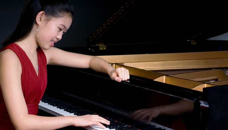 by: SUBMITTED PHOTO: RUIMING WANG - Adria Ye is rapidly becoming a world-class musical performer. The former Lake Oswego elementary school student plans a Portland concert on Friday.