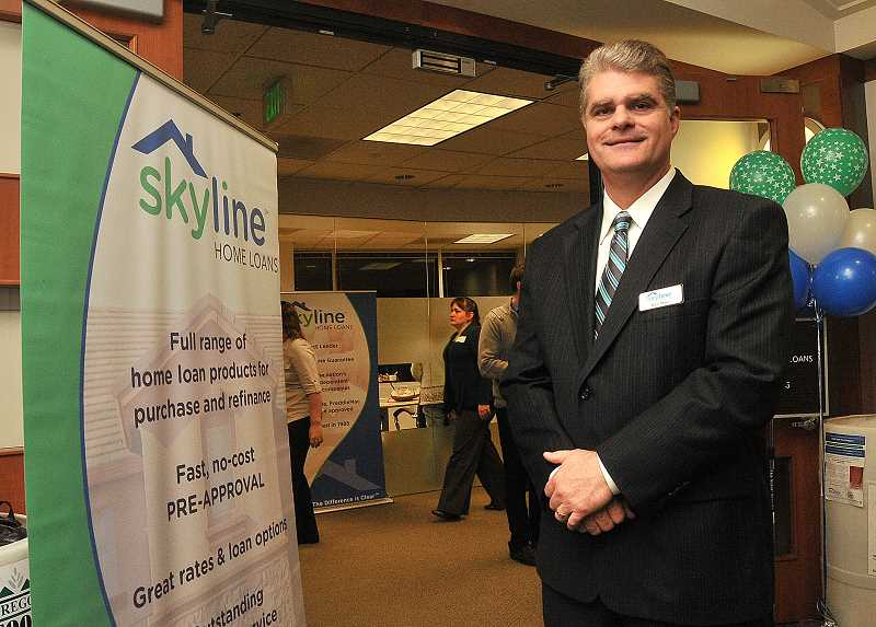 by: STAFF PHOTOS: VERN UYETAKE - Ken Maes, vice president of Skyline Home Loans Northwest division, is bullish on the home mortgage business.