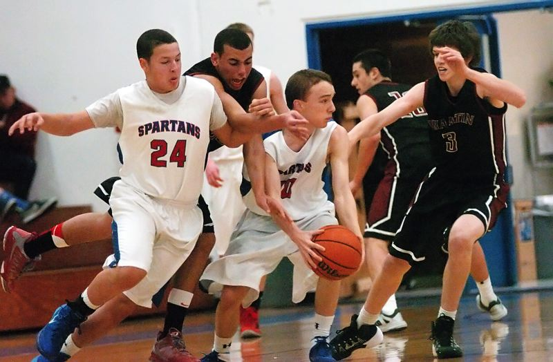 by: DAN BROOD - PRESSURE -- Tualatin junior Alexander Reid (second from left) and sophomore Nathan Senger (3) keep the heat on Hillsboro's Terell Mims (24) and Andrew Groh.