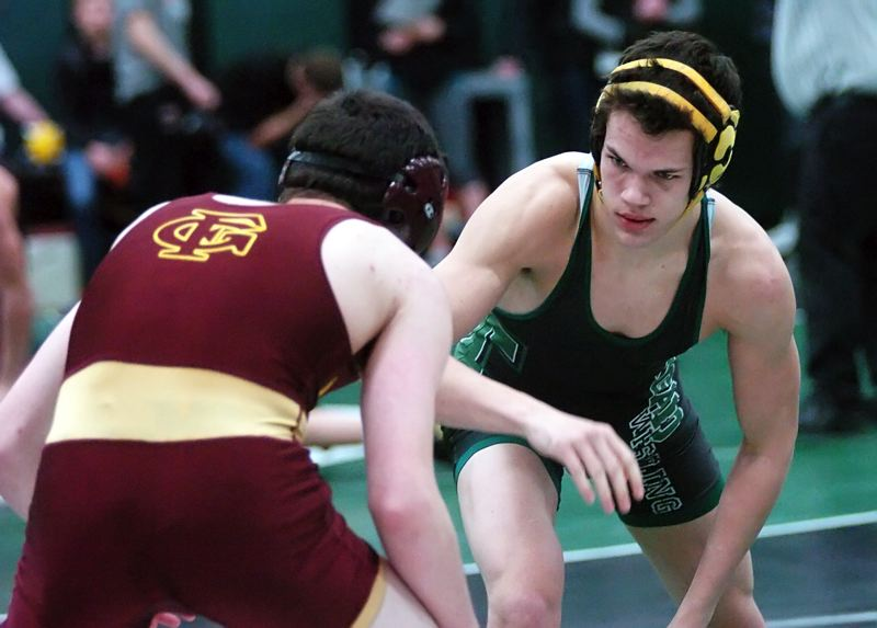 by: DAN BROOD - READY -- Tigard senior Justin Campbell (right) is set to lock up with Forest Grove's Alan Blood in their 152-pound third-place bout.