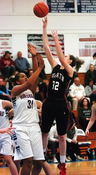 by: DAN BROOD - SURE SHOT -- Tualatin senior Savannah Heugly (right) shoots over Hillsboro's Tarea Green in Friday's game.