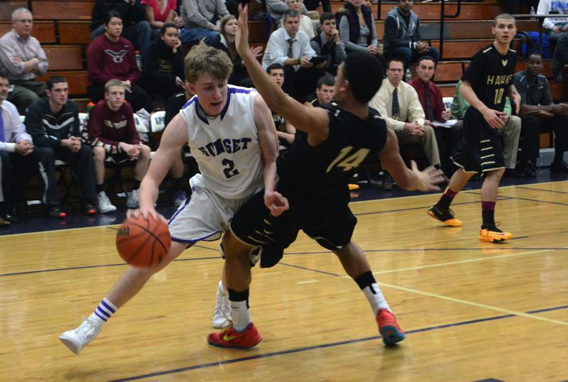 by: TIMES PHOTO: MATT SINGLEDECKER - Sunset senior forward Jeff Bieber tries to drive past Southridges Isaiah Reel in the first quarter of the Apollos win on Wednesday.