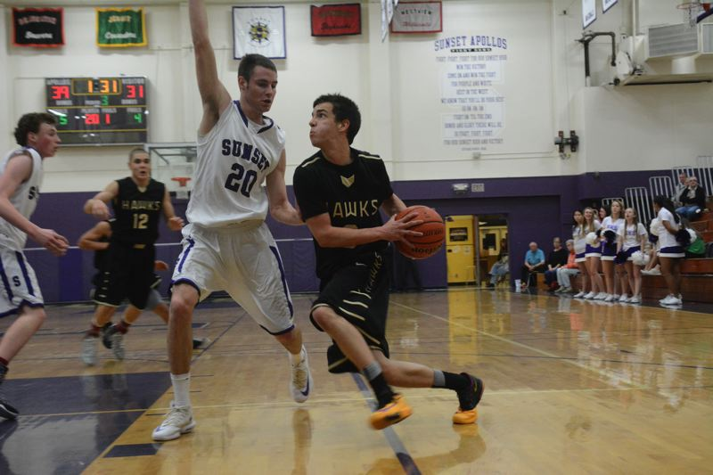 by: TIMES PHOTO: MATT SINGLEDECKER - Southridge senior point guard Grant Giraldi tries to get past Sunsets Michael Kearns on the baseline in the fourth quarter on Wednesday.