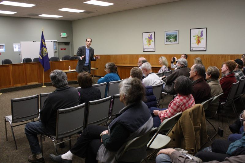 by: SPOTLIGHT PHOTO: ROBIN JOHNSON - U.S. Sen. Ron Wyden, D-Ore., fielded questions and comments at a Saturday, Jan. 25, town hall meeting on a variety of subjects, ranging from increased traffic of oil trains through the county to criticism of the Affordable Care Act.