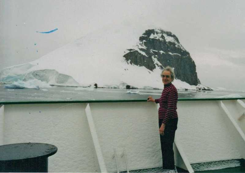 by: COURTESY OF ISABEL TORREY - A WORLD OF WHITE AND BLUE - Magnificent scenery can be viewed almost 24/7 in Antarctica, so to enjoy the view, Isabel Torrey stands on the deck of the Russian ship, Akademik Joffe.