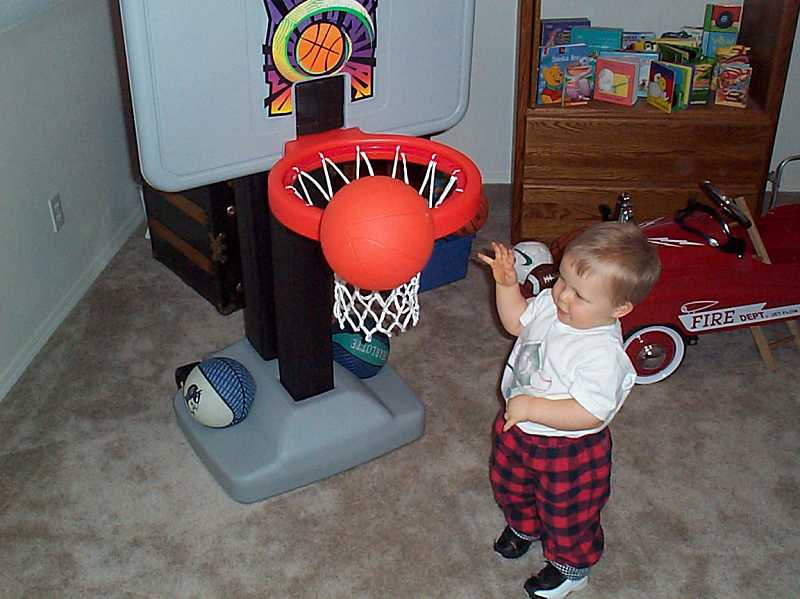 by: BILL REICHLE / COURTESY - A young Zach Reichle plays on his first Fisher Price hoop. A son of two former athletes, he is now a starter and key contributor on the Wilsonville boys basketball team.