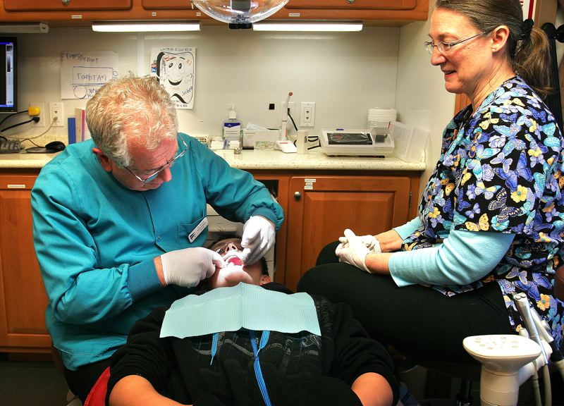 by: OUTLOOK PHOTO: JIM CLARK - Hayden Drake, a seventh-grade student, had his teeth cleaned and cavities filled Tuesday aboard the Tooth Taxi.