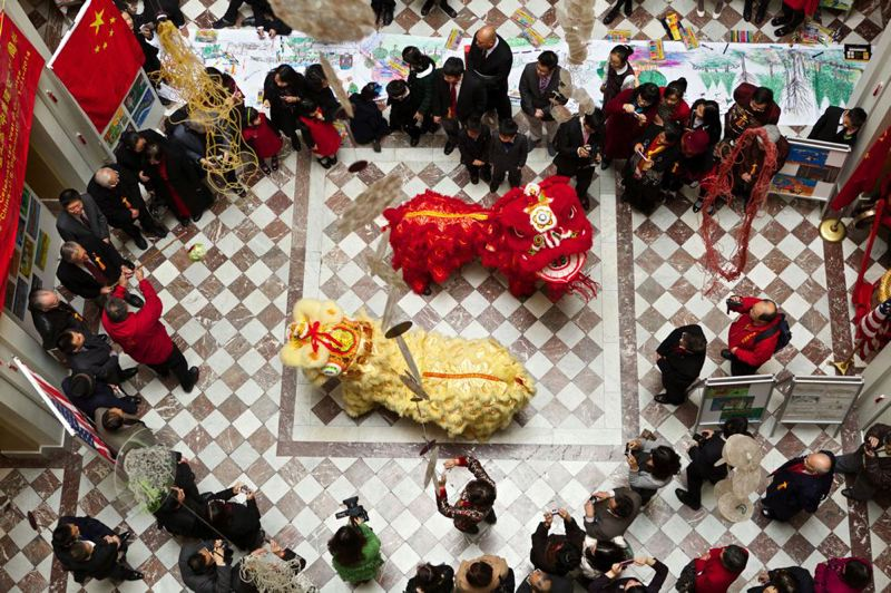 by: TRIBUNE PHOTO: JAIME VALDEZ - Members of the Portland Lee's Association Dagon & Lion Dance team perform during the celebration of the Year of the Horse at the Portland City Hall atrium. The lion dressed in yellow is Andrew Nguy,16, a junior at David Douglas High School. Dressed as the red lion is Gloria Saepharn,17, a senior from Benson Tech.