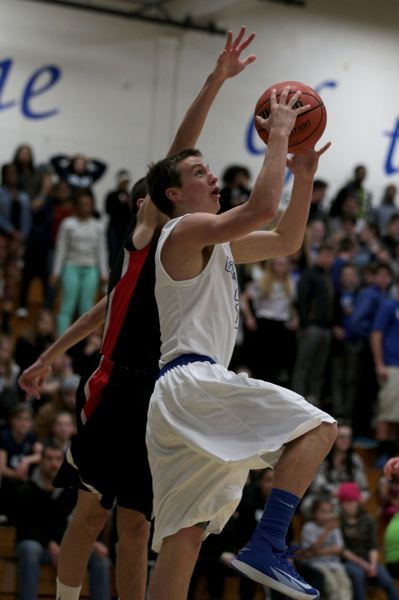 Grant's Luke Atherton tries to get to the hoop.