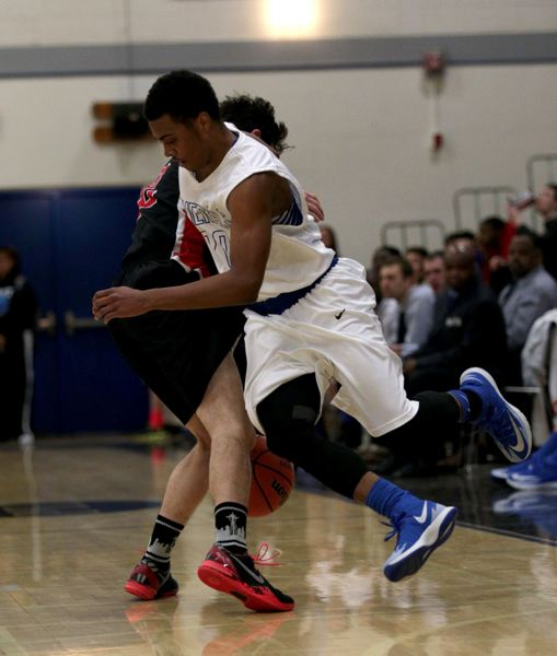 Grant's Alondre Augustus and Lincoln's Matt Peeler gets tangled up during their Class 6A game at Grant.