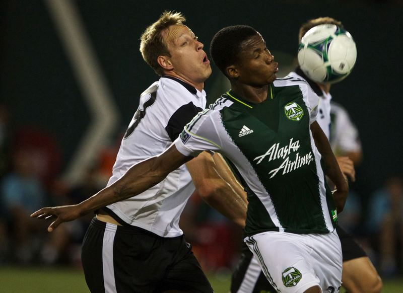 by: TRIBUNE FILE PHOTO: JAIME VALDEZ - Bright Dike (right) tries to control a ball against Norwich City in a July 2013 match with the Portland Timbers.