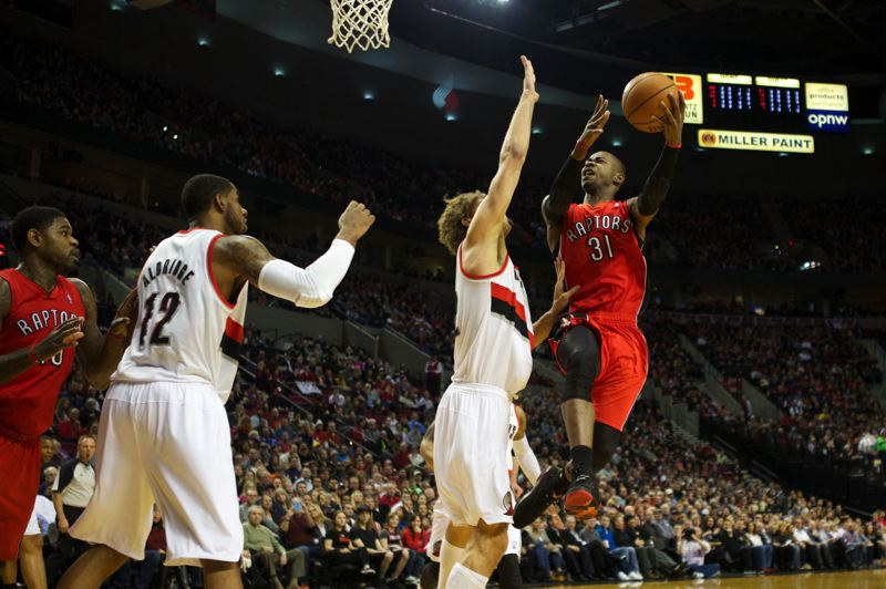 by: TRIBUNE PHOTO: JAIME VALDEZ - Terrence Ross shoots over Portland center Robin Lopez in the first half.