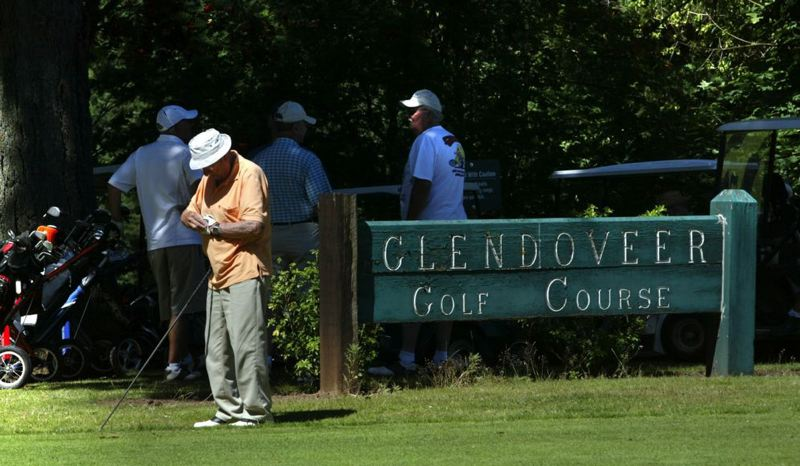 by: TRIBUNE FILE PHOTO: JIM CLARK - Golfers wait for their tee time at Glendoveer in Northeast Portland.