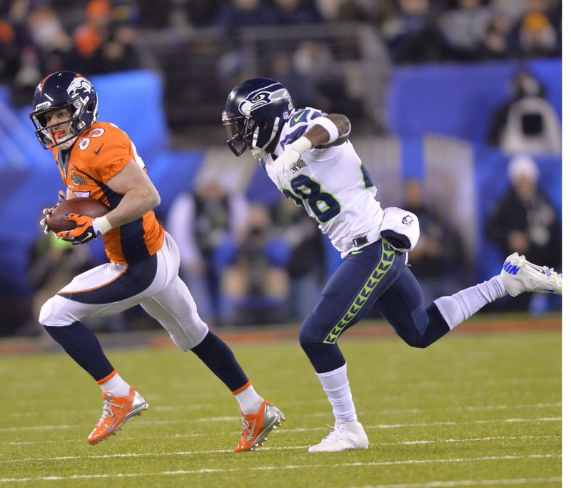 Oregon Ducks alum Walter Thurmond (right) pursues Denver receiver Wesley Welker as the Seahawks defense puts the clamps on the Broncos' high-powered offense.
