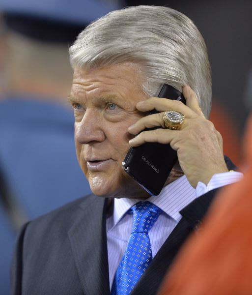 NFL analyst Jimmy Johnson takes a call as the Seahawks turn the Super Bowl into a 43-8 rout.