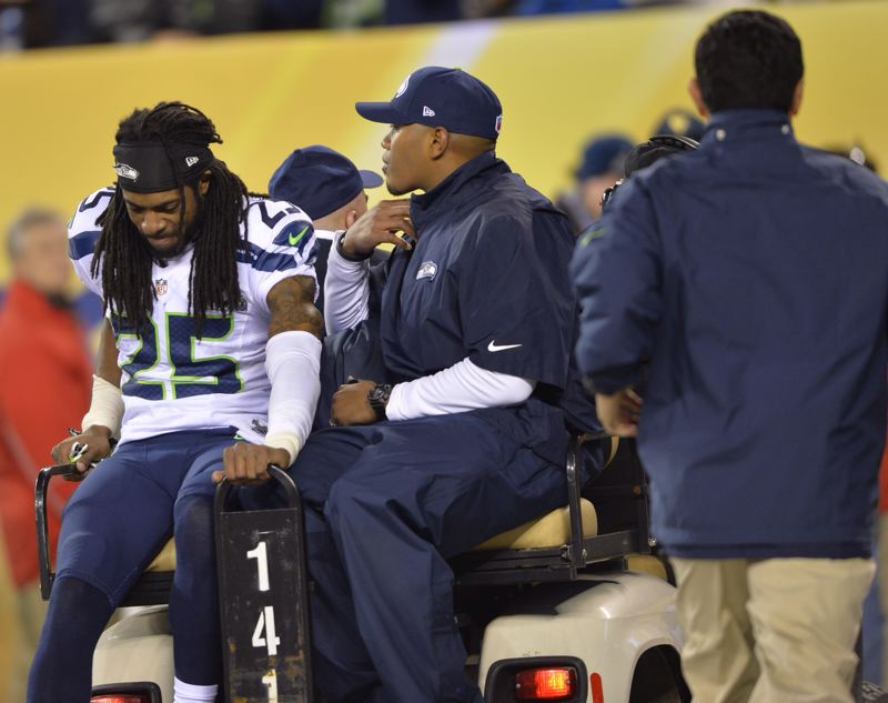 Seattle cornerback Richard Sherman leaves the game with an injury.