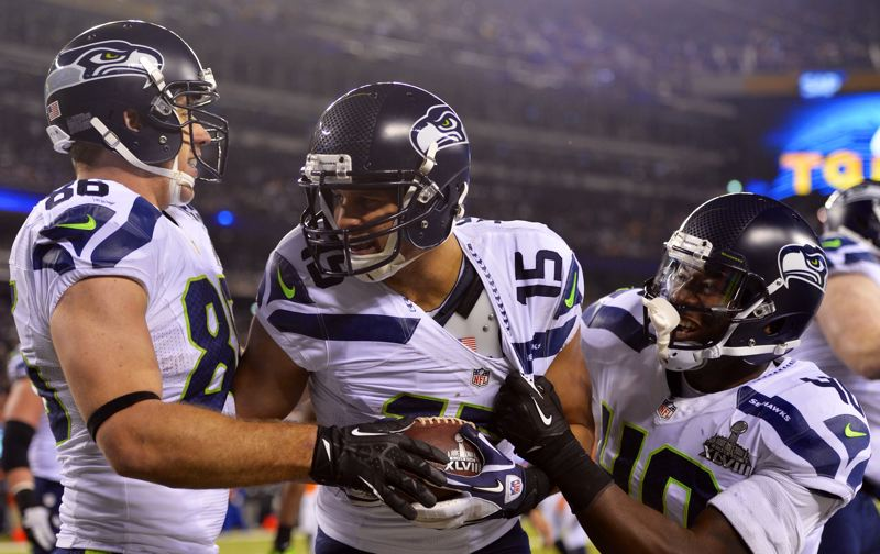 Jermaine Kearse (center) celebrates his 23-yard touchdown catch in the third quarter with teammates Zach Miller and Derrick Coleman. The score gave the Seahawks a 36-0 lead.