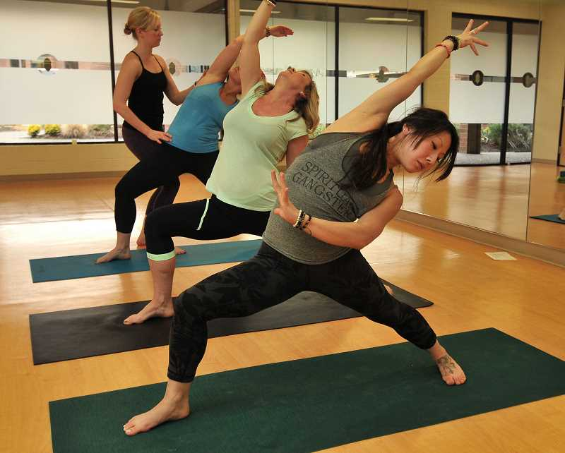 by: REVIEW, TIDINGS PHOTO: VERN UYETAKE - Twist Yoga instructor Ali Matt puts three students through a hot workout at the studio on Mercantile Drive. As studio owner Jennifer Pahl says, they Twist like theres no tomorrow.