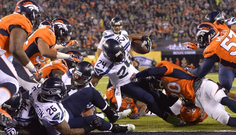 Marshawn Lynch gets through the Broncos line for Seattle's first touchdown of Super Bowl XLVIII.