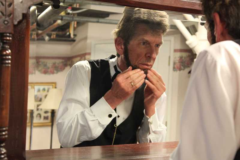 by: SUBMITTED PHOTO - Steve Holgate puts on the beard to transform himself into Abraham Lincoln for A.Lincoln. The show will be presented Feb. 17 at Lakewood Theatre Company.