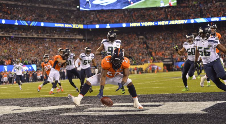 Denver's Knowshon Morena gets to the ball for a safety, averting a possible Seattle defensive touchdown, on the first snap from scrimmage - which got past the unsuspecting Broncos quarterback, Peyton Manning.