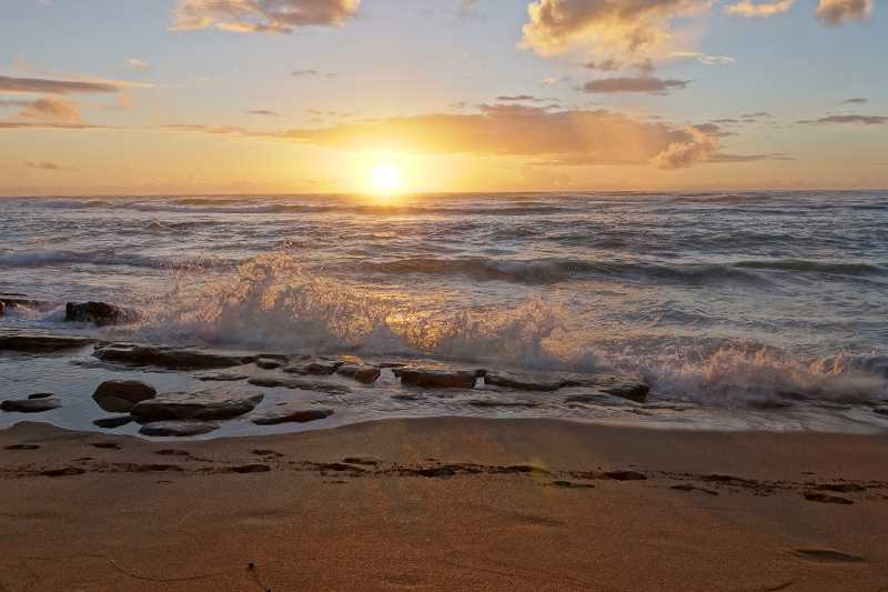 by: AARON KEEFER - Editor Lindsay Keefer, her husband and her parents visited three islands in Hawaii last month. This photo was taken at sunrise from the place they stayed on the east coast of Kauai.