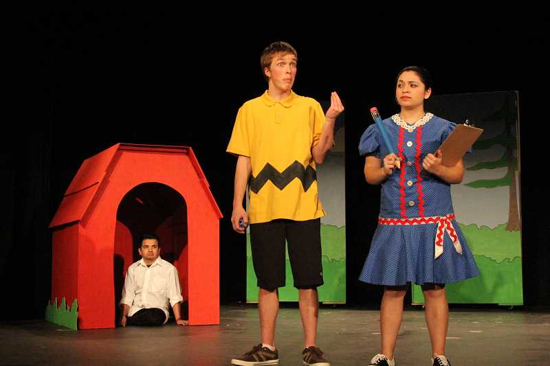 by: LINDSAY KEEFER - Tyler Lulich (center) and Sofia Velasquez (right) act out a scene from 'You're a Good Man, Charlie Brown' as Charlie Brown and Lucy, respectively, while Oziel Riestra, who plays Snoopy, looks on. The show will play Feb. 7, 8, 14 and 15 at 7 p.m. Tickets are $5 for adults, $3 for students and seniors.
