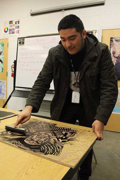by: LINDSAY KEEFER - Senior Alfonso Calixtro, who demonstrates the printmaking process, was awarded five Gold Keys in addition to receiving an American Visions Nomination, or Best in Show, for his printmaking piece, 'Self Portrait of Zapata.'