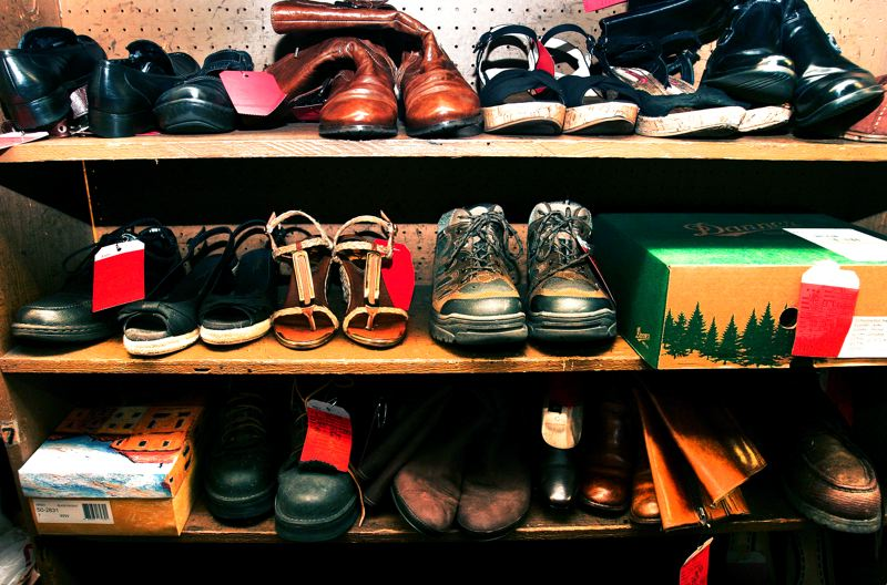 by: OUTLOOK PHOTO: JIM CLARK - As other shoe stores close, Gresham Shoe Repair becomes busier, with customers coming from as far away as Hood River.