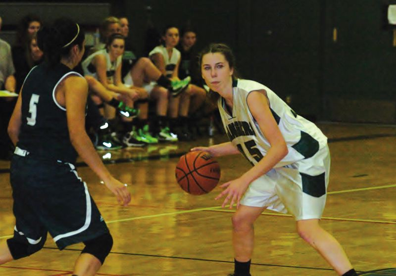 by: ESTACADA NEWS: PARKER LEE - Estacadas Kristen Kiser runs the offense from near halfcourt during the teams 60-51 win over North Marion.