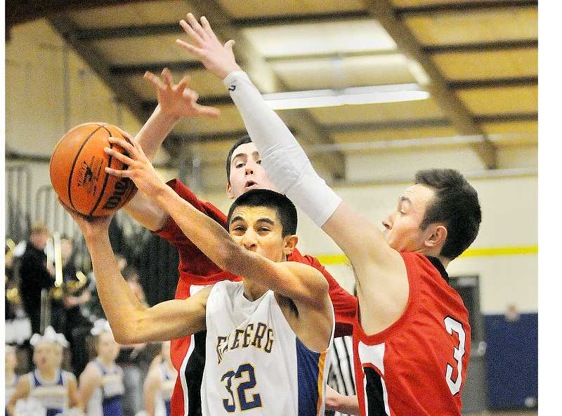 by: SETH GORDON - Catalyst - Sophomore point guard B.J. Ulloa's 20 points boosted the Tigers to a 71-63 upset of Forest Grove Jan. 28 at home.