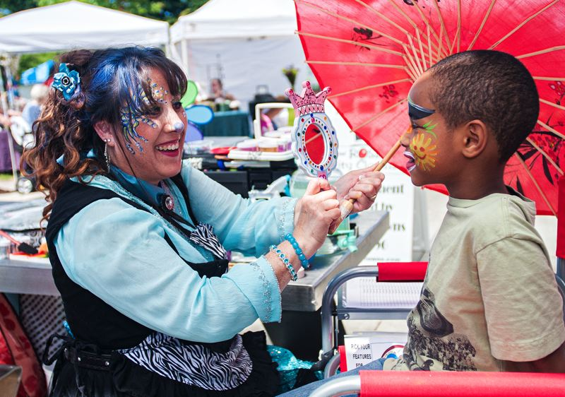 by: SPOKESMAN FILE PHOTO: JOSH KULLA - The 2013 Wilsonville Festival of Arts was held in Town Center Park, but suffered somewhat from lower than normal attendance. Now organizers are trying to revamp and revitalize the event. Shown here is Wilsonville girl MoNiqueko Johnson and facepainter Desiree Seibl.