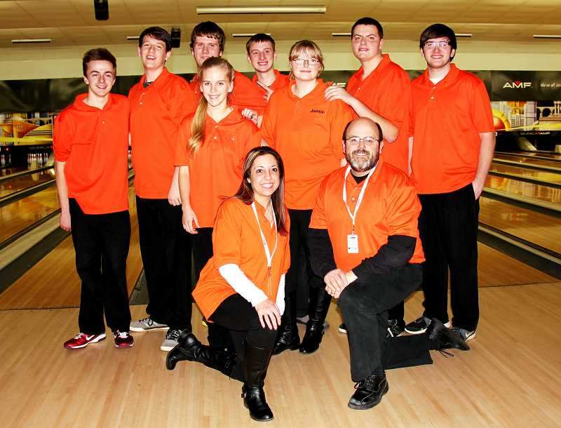 by: PHOTO COURTESY OF JULIE JOHNSON - Molalla's bowlers at the district tournament. From left to right, front row: Coaches Teri Copeland and Shawn Copeland. Middle row: Kristen Blank, Jamie Mewing, Jacob Mewing, and Skyler Foster. Back row: Jared Johnson, Lane Phillips, Andrew Sherwood, and Jared Hartrampf. Not pictured: Marshall McDonald.