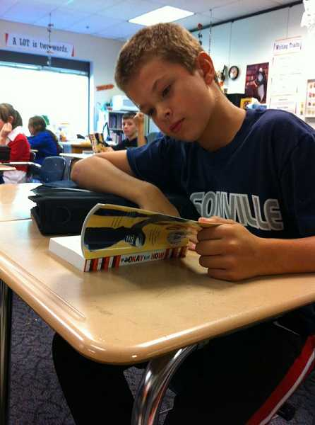 by: SUBMITTED PHOTO - Sixth-grader Nick Ackerman is among 715 students at Inza R. Wood Middle School reading Okay for Now by Gary Schmidt this school year.