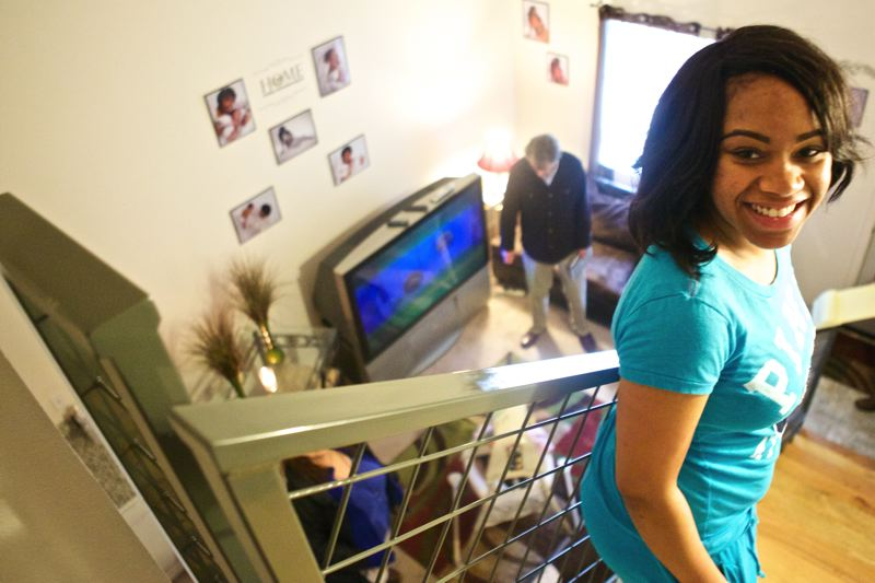 by: TRIBUNE PHOTO: JAIME VALDEZ - At  her old studio apartment, Kemiyia Hunt and her daughter Zoey Sims did not have her own washer and dryer, a dishwasher, granite counter tops in the kitchen, bathroom cabinets or two full bedrooms. Shes got all those at the new Snowberry Apartments that were built for $70,000 per unit. The Snowberry, according to developer RobJustus, shows that quality low-income housing can be built inexpensively.