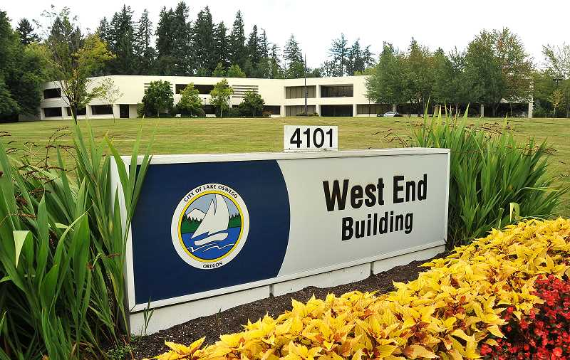 by: REVIEW FILE PHOTO - The city hopes to sell the West End Building on Kruse Way to a private developer, but the deal hinges on rezoning the site from office campus to general commercial. Planning commissioners will consider that idea for a second time in March.