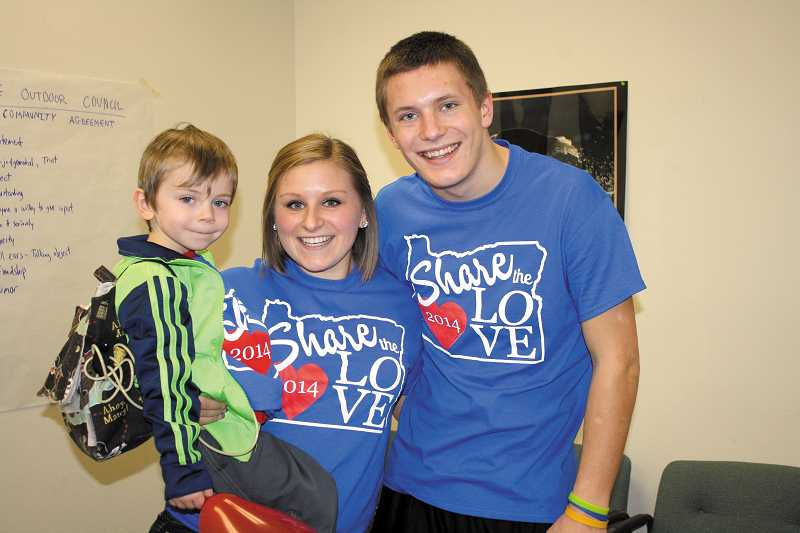 by: PEGGY SAVAGE - Naysen with Molalla High School Share the Love organizers Ashley Alexander and Drew Vandenbroeder.