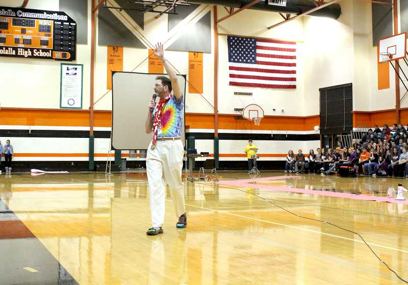 by: CORY MIMMS - MHS teacher Joe Zenisek stirs up the assembly with a rousing pep talk to Share the Love. The students raise funds for a local family each year through the month-long fundraiser, and Zenisek has led the efforts each year as an adivsor.