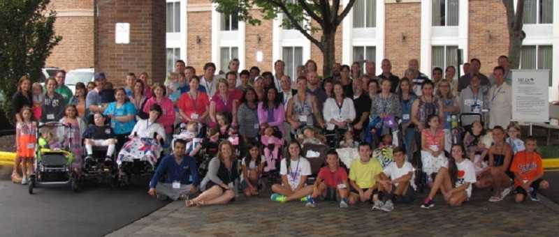 by: SUBMITTED PHOTO - Families and doctors gathered at a family conference held by the MLD Foundation last summer.