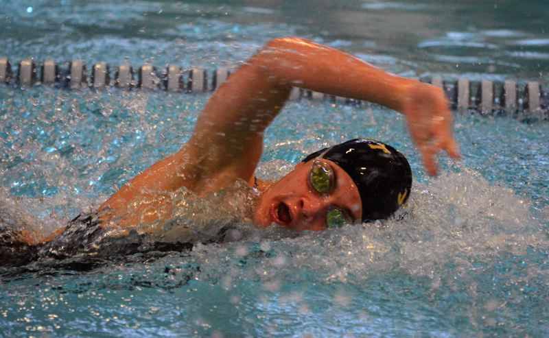 by: TIMES PHOTO: MATT SINGLEDECKER - Jesuits Erin Cook won the 50 freestyle for the Crusader girls swim team against Sunset on Thursday.