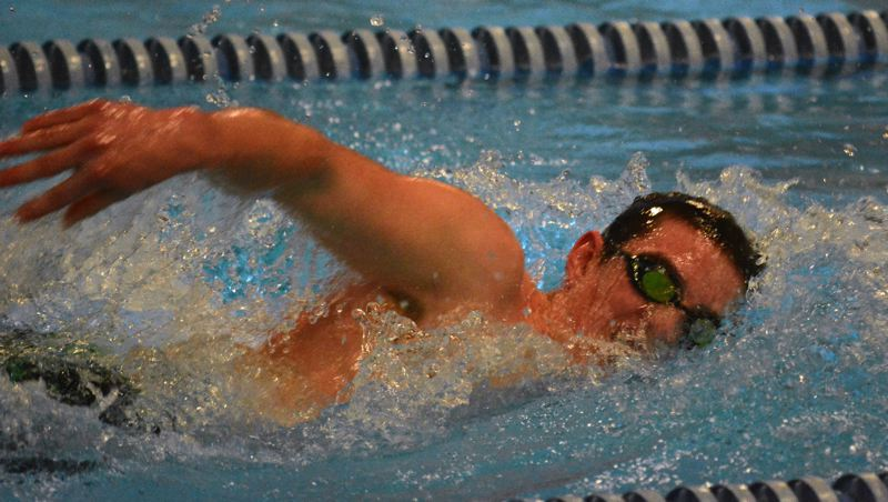 by: TIMES PHOTO: MATT SINGLEDECKER - Jesuit boys swimmer Sean Calkins won the 500 free and 100 backstroke for the Crusaders, who came within six points of Sunset on Thursday.