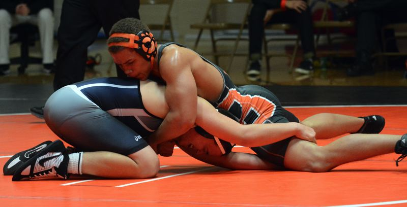 by: TIMES PHOTO: MATT SINGLEDECKER - Beaverton 170-pound Apollo Zerkle beat Westviews Daniel Durfee by decision during the Beavers dual meet match at home on Thursday.
