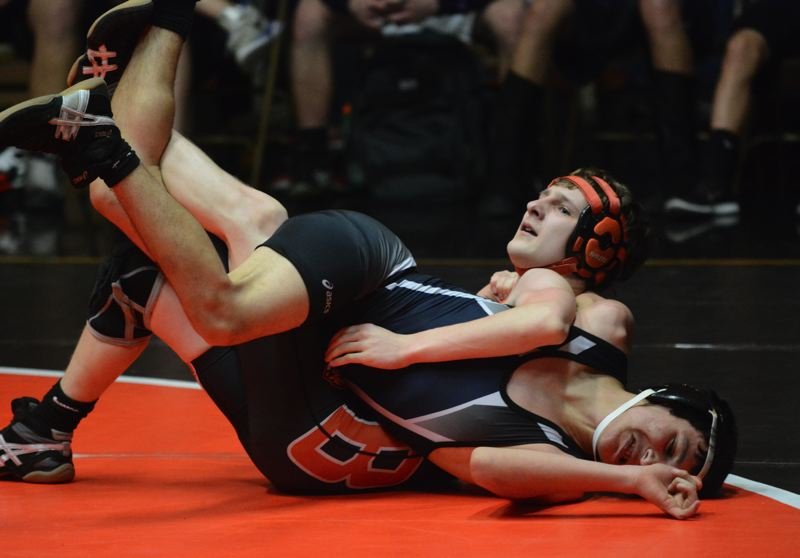 by: TIMES PHOTO: MATT SINGLEDECKER - Beaverton 113-pound Cary Flanigan won by major decision over Westviews Juan Garica-Hernandez on Thursday to score five team points for the Beavers.